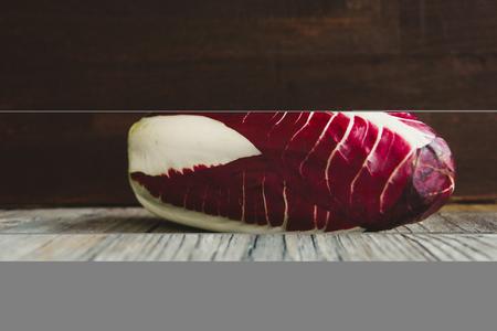 Radicchio, red salad on wooden board Reklamní fotografie