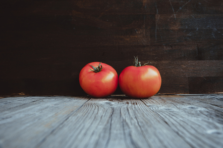 Tomatoes on the old wooden table