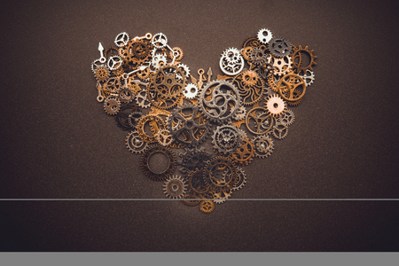 heart shaped symbol from old brass gears isolated on burnished background 版權商用圖片