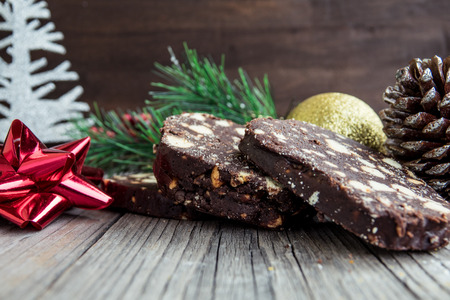 Chocolate dessert salami decorated for Christmas Reklamní fotografie