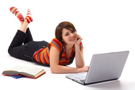 Yong student woman whit book and laptop isolated on white photo