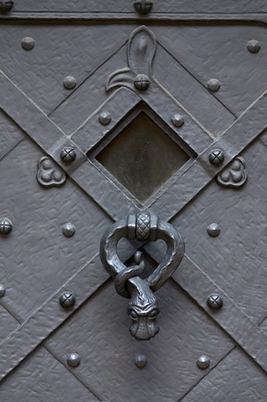 The ancient forged door with the handle in the form of the snake Stock Photo - 1366548