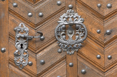 old handles on an oak door Stock Photo - 1396868