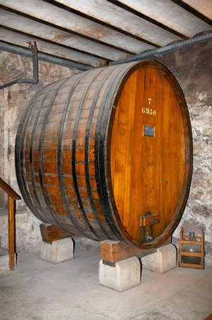 Ancient wine cask in a cellar
