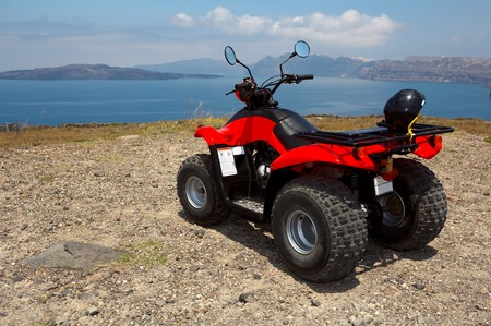 Four wheel drive red and black quad bike