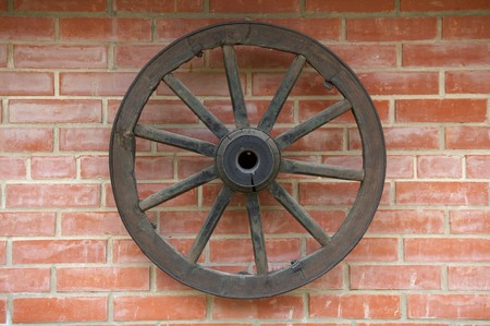Old Wagon Wheel on brick Wall Stock Photo - 4013649