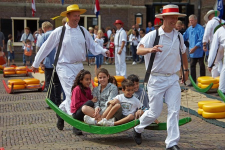 Cheese festival in city Alkmaar - the Netherlands.After sale of cheese porters on a stretcher instead of cheese roll children. 14.08.2009 Editorial