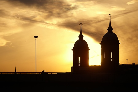 Silhouettes of domes and the people at sunset