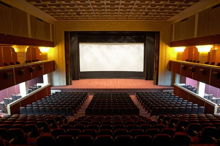 emptiness: Hall of a cinema and lines of red armchairs