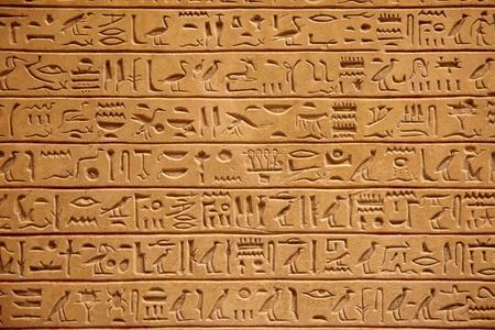 Egyptian hieroglyphics on the stone wall