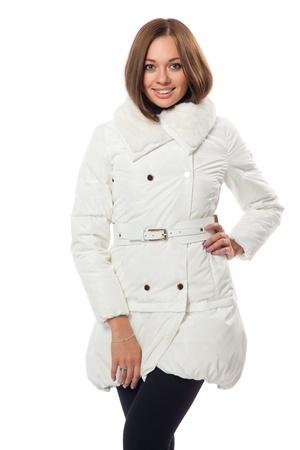 studio shot smile girl in a white downy coat Stock Photo