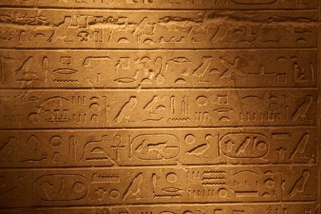 writing western: Egyptian hieroglyphics on the stone wall