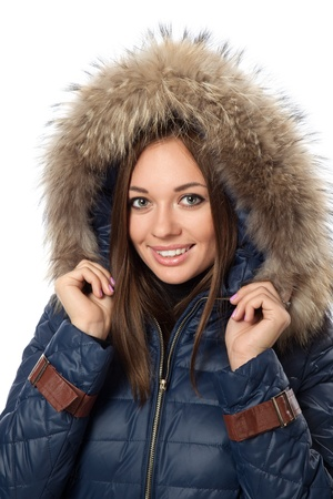 The smiling woman in a winter coat with fur hood