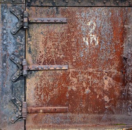 Rusty steel door and door hinges Stock Photo