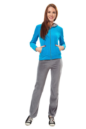 Woman in warm sportswear isolated on white Stock Photo