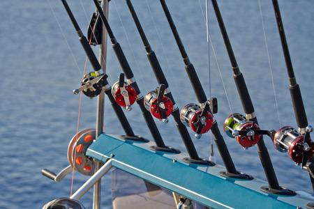 trolling: Six fishing rods and reels fishing line Stock Photo