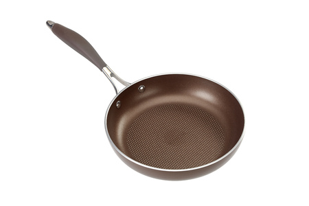 fluted: Brown coated Teflon frying pan isolated on white with fluted bottom Stock Photo