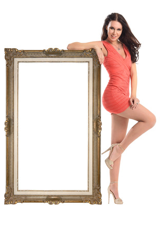 women legs: Beautiful girl with  picture frame in a short dress isolated on white Stock Photo