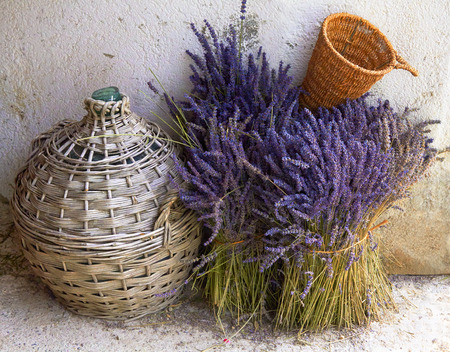 Still-life with a bouquet of lavender basket and bottle. Provence. France Banque d'images