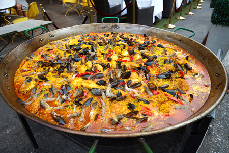 large: Large fideua a paella in the street restaurant, Provenc, Arles