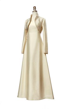 veiled: Light beige evening dress with bolero on a mannequin