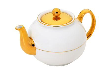 taza de té: Tetera blanco con oro aislado en blanco Foto de archivo