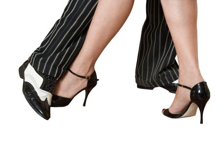 dance steps: Mans and female feet dancing tango