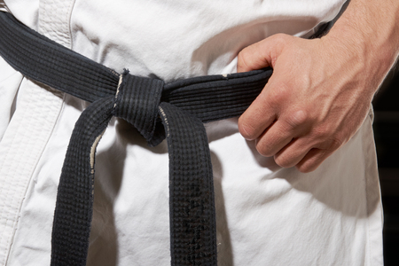 black belt: Karate stance hand and black belt