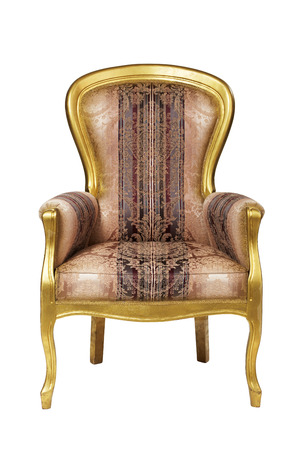 Classic ancient armchair with golden wood  isolated on white
