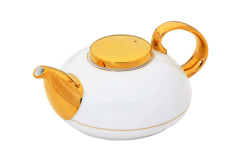 White teapot with gold and ceramic handle isolated on white