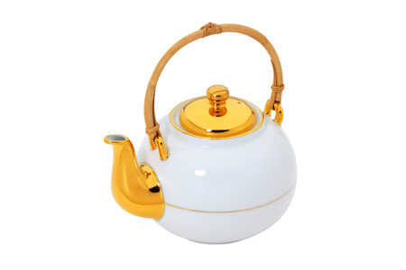 White teapot with gold and wooden handle  isolated Stock Photo