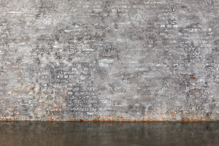 The gray brick wall and floor as a background Stock Photo