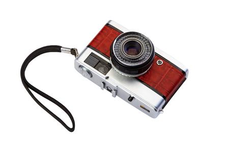 Old compact film photo camera with crocodile skin finish isolated