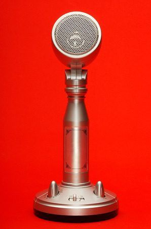 Stylish metal microphone isolated on red with clipping path Stock Photo