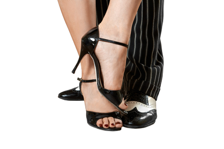 Mans and female feet dancing tango Isolated on White with Clipping Paths