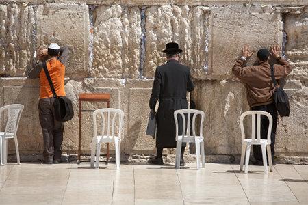 JERUSALEM - APRIL 02, 2008: Orthodox Jews pray at the Wailing Wall (Western Wall), Jerusalem Editorial