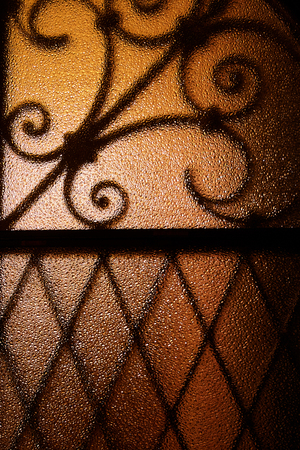 Shadow shaped metal grid on color glass