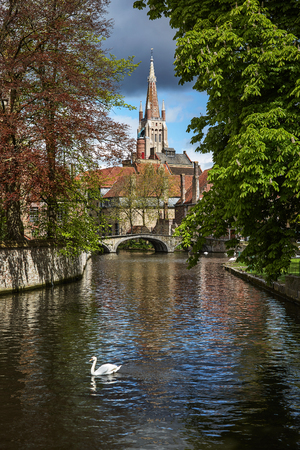 View from Minnewater on Church of Our Lady, Bruges Stock Photo
