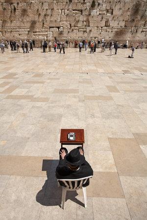 JERUSALEM - APRIL 02, 2008: An Orthodox Jew with a book Torah prays at the Wailing Wall (Western Wall), Jerusalem Editorial