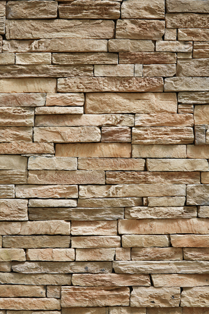 stone wall brick texture background beige surface facade Banque d'images