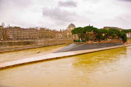 tevere: View across the River Tiber to Isola Tiberina in Rome. The island was modeled to resemble a ship by the romans in the 2nd century BC Stock Photo