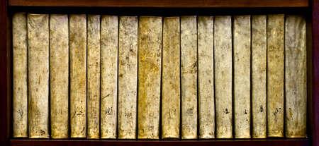 xvi: ancient books (XVI century) on a wood shelf