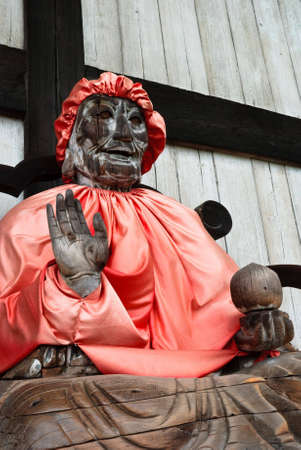 Binzuru (Pindola): wooden statue of Buddha at the entrance of Todai-ji temple in Nara, Japan. Stock Photo - 5789809