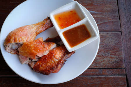 sauces: Thai food grilled chicken with sweet and tamarind sauces