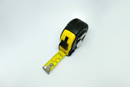 Yellow measuring tape isolated cut out on white background 写真素材