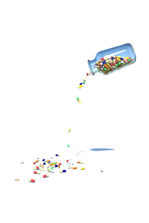 Medicine spilling from the bottle photo