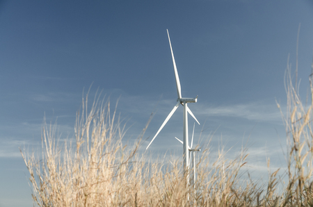 Wind generator farming in dreen world energy concept in vintage tone Imagens