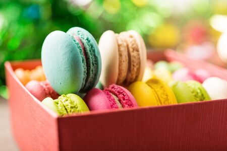 Macaroon mixed colorful in the present box for gift in warm tone celebration