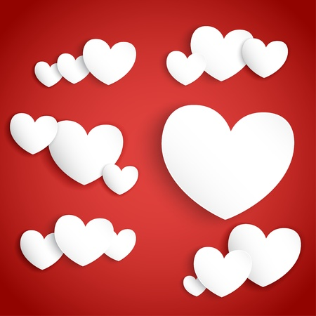 White paper hearts on red background with soft shadows