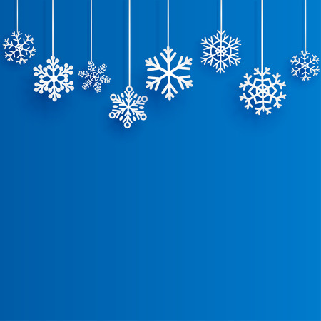 Christmas background with several hanging snowflakes on blue background